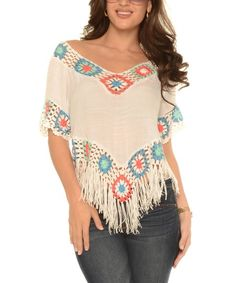Bright crochet inserts and swingy fringe update this contemporary top.