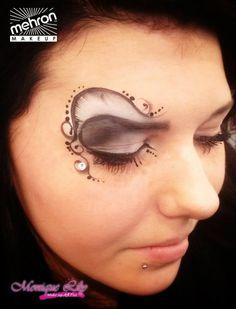 Monique Lily's eye design Mehron paradise makeup AQ white, storm cloud & black - paradise detailz black - ad gem/ rhinestone  @ Mehron booth, Cosmetica Hannover