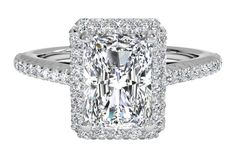 14kt White Gold (0.21 CTW) with a 0.31 Carat, Radiant Diamond. Rectangle cut extended halo setting.