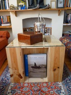 Easy DIY coffee table from wine crates- Take 6 wine crates, stand them on their sides and throw some glass on top. (From Offbeat Home & Life) Yeah, this is so happening.