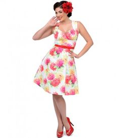 Vibrant, flirty, and #floral. A #summer essential! #uniquevintage #pinup