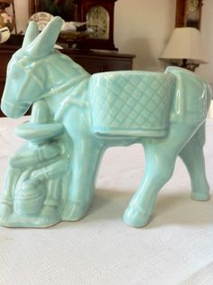 McCoy Pottery Dozing Mexican and Donkey Planter - Blue Glazed. I think my grandma had this in white. Wish I had it now.