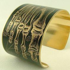Bracelet w anatomical human foot skeleton.