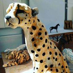 It's photoshoot time. The cheetah is looking majestic don't you think? #artinaction #ceramicanimals #ceramics