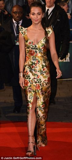 The actress, 29, exuded elegance in the low-cut number, which boasted a pretty floral pattern and ruffled detailing on the shoulders.