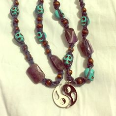 """Yin Yang Handmade Hemp & Amethyst Friendship Made by me. Materials used: blue hemp cord, amethyst square stones, blue skull beads, brown wood beads. White one is a little more worn than the black side; spiral of hemp is stretching on one side. Black necklace closes by tying hemp together, it's around 22"""" total length. White closes with clasp, it's almost 28"""" in total length. Will consider fixing white side for higher price, but it looks fine as is. **All items hand washed and sterilized…"""