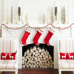 stacked logs in firebox and tree medley on mantel