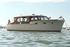 34' 1953 Chris Craft Deluxe Enclosed Cruiser. This boat is without a doubt one of the finest examples remaining of the old style sedan without a flybridge.