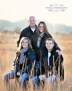 photo images of a family of four posing | pose for family photo shoot