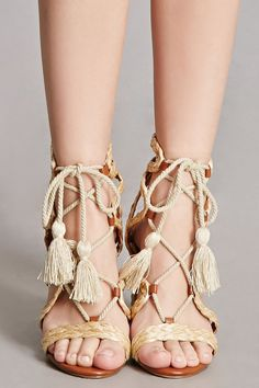 22f184130d8a93 A pair of block heel sandals by MIA™ featuring braided straw accents