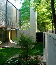 Along the entire west side of the house, a lush courtyard creates private exterior space that can be enjoyed during much of the year in A...