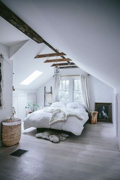 This rustic attic bedroom didn't always look this cozy. Check out the before + after of this space on the west elm blog.