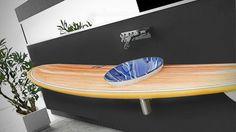 Tabla de surf convertida en mueble de lavabo