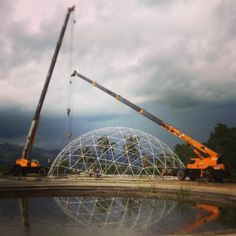 Massive cranes. Geodesic Dome, Sustainable Development, Public Spaces, Event Venues, Sustainability, Construction, Building, Architectural Engineering