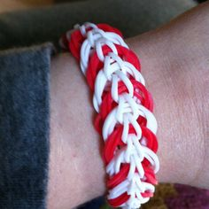 A candy cane themed Rainbow Loom Triple Link bracelet.  http://loomlove.com/make-triple-link-chain/
