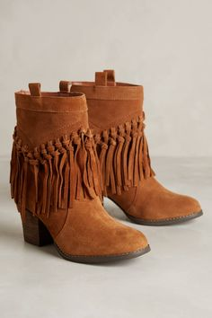 Can't you just picture these with jeans or leggings?  Knotted Fringe Booties :: anthropologie.com