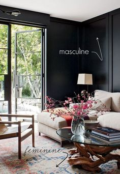 just awesomely eclectic, how warm and enveloping those black walls are in combination with the fabulous oriental rug...