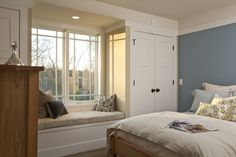 Closets placed on either side of a window, creates comfy, light filled seating. (Sarah Susanka, designer)
