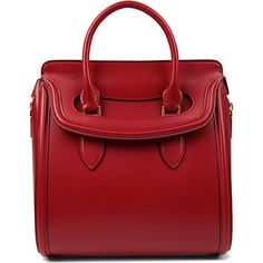 Alexander mcqueen    ALEXANDER MCQUEEN  Heroine medium leather tote  £1,525.00    Highly-structured in red leather, Alexander McQueen's Heroine tote will lend a hit of new-season polish to your professional portfolio. Carry it to stamp your style authority in the boardroom and beyond. (Height 37cm, width 30.5cm, depth 18cm, handle drop 11cm)