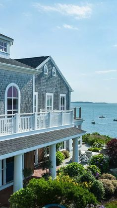 Wequassett Resort; Harwich ~ cedar shake shingles, soft blue paint and the ocean.  Wish I was there.