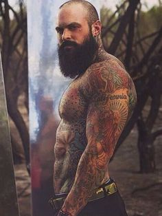 I'm mesmerized by the tattoos on his hot body..The furry face is an added bonus for sure