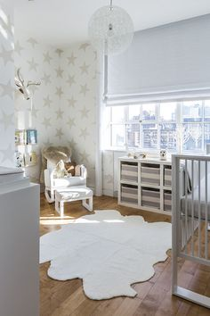 modern nursery with Sissy + Marley Lucky Star Wallpaper framing white rocker