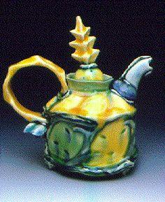 "Rebecca Harvey  Teapot  Press molded and Thrown Porcelain/Polychrome Glazes  8""x5""x7""  1994"