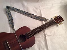 Ravelry: Ukulele Strap pattern by Lise Gray. It works very well. Uke doesn't flip forward, comfy.