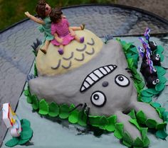 My two daughters on top of Totoro's tummy cake with a row of Makkurokurosukes.  Using coloured ganache method for the first time on dark chocolate and orange mud cake.