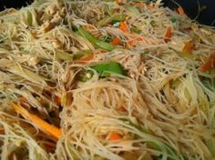 Stir fried rice noodles cooked with chicken or pork and vegetables like cabbage, carrots, celery, snap beans or green beans. Filipino Pancit Bihon Recipe – Noodles for Long Life - Filipino Pancit Bihon Recipe – Noodles for Long Life! Filipino Noodles, Filipino Food, Lumpia Recipe Filipino, Asian Noodles, Chinese Rice Noodles, Filipino Appetizers, Paula Deen, Pancit Bihon Recipe, Pancit Recipe Shrimp