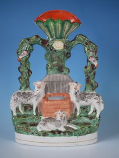 Staffordshire sheep at well spill vase