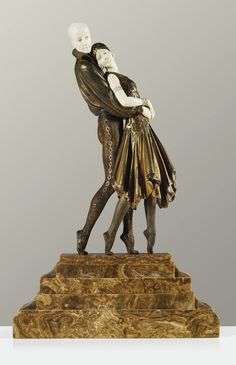 "** Demetre H. Chiparus (Romanian, 1886-1947)  ""TANGO"", A COLD-PAINTED, PARCEL-GILT AND SILVERED BRONZE AND CARVED IVORY SCULPTURE ON ONYX BASE, CIRCA 1921."