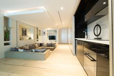 A Hidden Bed Drops From The Ceiling In This Compact Living Space