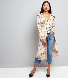 Petite. Add a feminine frill to your wardrobe this season. Layer this floral midi dress over jeans and add pointed heels to lift the look.- All over floral print- V neckline- Frill trim shoulders- Simple long sleeves- Button front fastening- Midi length- Dress length (as shown): 41