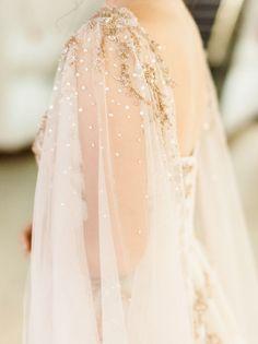 Gorgeous beaded bridal cape: http://www.stylemepretty.com/2015/12/22/los-angeles-night-at-the-museum-wedding/ | Photography: Honey Honey - http://www.hoooney.com/: