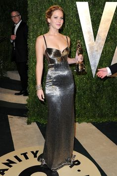 55c9b7b8be63 ... Jennifer Lawrence arrives at the 2013 Vanity Fair Oscar Party hosted by  Graydon Carter at Sunset Tower on February 2013 in West Hollywood