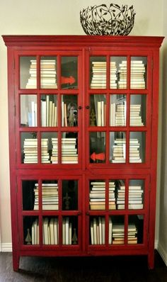 amazing red bookcase -- and I have two bookcases like this that could use a makeover!