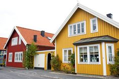 Old village yellow house in Sweden with white trim and small garage next to classic red Swedish house. Yellow House Exterior, House Paint Exterior, Exterior Design, Exterior Shutters, Exterior Stairs, Cottage Exterior, Black Exterior, Scandinavian Architecture, Scandinavian Style Home