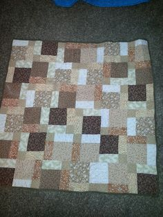 Disappearing 9  patch in various browns and whites.