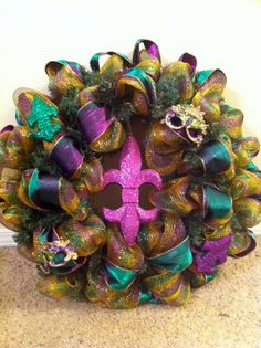 Mardi Gras Deco Mesh wreath with glitter fleur de lis and mask ornaments
