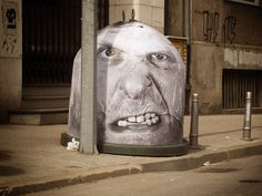 Wheatpaste art for garbage cans by Mentalgassi