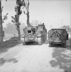 Sexton self-propelled gun moving up towards Escoville during Operation 'Goodwood', 18 July 1944.