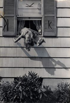 A model demonstrates how one can be injured in a home accident while trying to wash the outside of one's windows; the article recommends using a ladder or letting the man of the house do the task. 1959