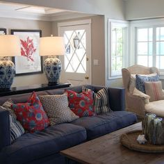 Blue sofa with red pillow accents.  Traditional Home Blue Sofa Design Ideas, Pictures, Remodel, and Decor - page 3