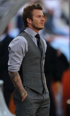 matching vest and pants? (Black?) Black tie. Cuffed sleeves