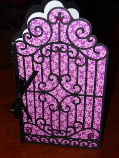 """Made with the Cricut Ornamental Iron cartridge.  I designed this using my Gypsy and cut it from an 8 1/2"""" x 11"""" piece of cardstock.  (I created a mirrored image and welded the two into one piece which I folded in the middle after cutting.)  The black ornamental iron layer overlays the front of the card base."""
