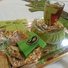 Green favors presented with tea
