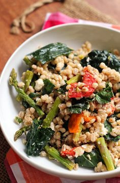 A hearty side or lunch salad, this farro salad with honey-roasted garlic tomatoes, asparagus, and kale is a celebration of healthy eating!
