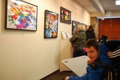 Perry McNiff of Rye Neck visits the Katonah Village library to see some of the paintings he and other Pines Bridge students had created. The paintings were on display at the library for a week in February 2015.