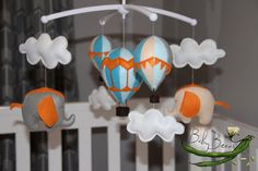 With MUSICAL CRIB ATTACHMENT. Orange & turquoise blue hot air balloons and elephants rotating musical mobile. Ready to ship. Baby Beans nz